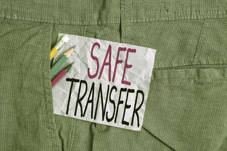Conceptual hand writing showing Safe Transfer. Concept meaning Wire Transfers electronically Not paper based Transaction Writing equipment and purple note paper inside pocket of trousers