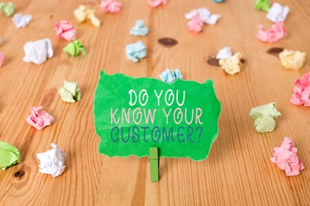 Word writing text Do You Know Your Customer Question. Business photo showcasing service identify clients with relevant information Colored crumpled papers empty reminder wooden floor background clothespin Foto de archivo - 129854152