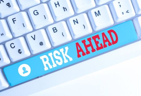 Word writing text Risk Ahead. Business photo showcasing A probability or threat of damage, injury, liability, loss White pc keyboard with empty note paper above white background key copy space