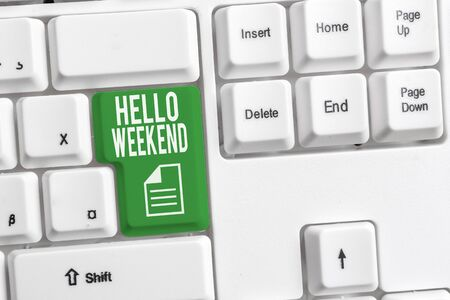 Conceptual hand writing showing Hello Weekend. Concept meaning Getaway Adventure Friday Positivity Relaxation Invitation White pc keyboard with note paper above the white background