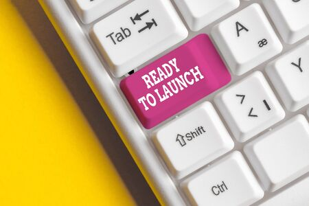 Conceptual hand writing showing Ready To Launch. Concept meaning an event to celebrate or introduce something new to market White pc keyboard with note paper above the white background