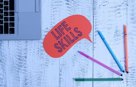 Handwriting text writing Life Skills. Conceptual photo skill that is necessary for full participation in everyday life Open laptop blank speech bubble pens ballpoints lying vintage wooden table