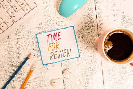 Writing note showing Time For Review. Business concept for review of a system or situation in its formal examination Technological devices colored reminder paper office supplies