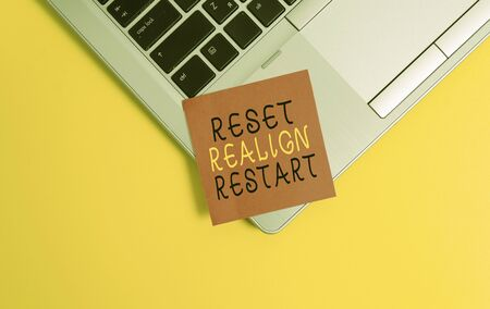 Writing note showing Reset Realign Restart. Business concept for Life audit will help you put things in perspectives Metallic trendy laptop blank sticky note empty text colored background Stock Photo