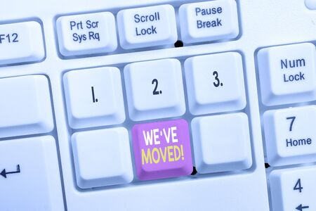 Conceptual hand writing showing We Ve Moved. Concept meaning To go from one residence or location to another Relocate White pc keyboard with note paper above the white background
