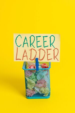 Handwriting text Career Ladder. Conceptual photo Job Promotion Professional Progress Upward Mobility Achiever Trash bin crumpled paper clothespin empty reminder office supplies yellow
