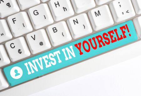Word writing text Invest In Yourself. Business photo showcasing nvesting in a coach or a training to learn new things White pc keyboard with empty note paper above white background key copy space