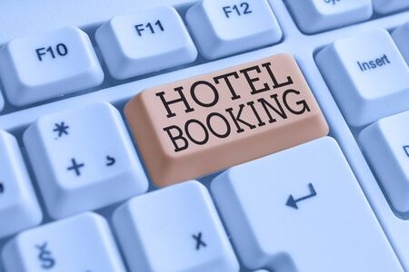 Conceptual hand writing showing Hotel Booking. Concept meaning Online Reservations Presidential Suite De Luxe Hospitality White pc keyboard with note paper above the white background