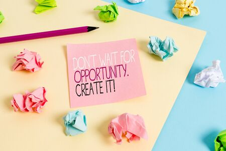 Writing note showing Don T Wait For Opportunity Create It. Business concept for work hard on yourself and begin from this moment Colored crumpled papers empty reminder blue yellow clothespin