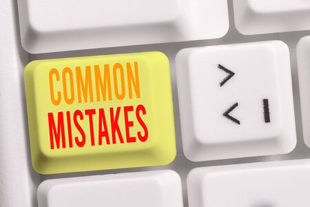 Handwriting text writing Common Mistakes. Conceptual photo actions that are often used interchangeably with error White pc keyboard with empty note paper above white background key copy space 스톡 콘텐츠