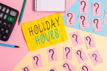 Writing note showing Holiday Hours. Business concept for employee receives twice their normal pay for all hours Mathematics stuff and writing equipment above pastel colours background