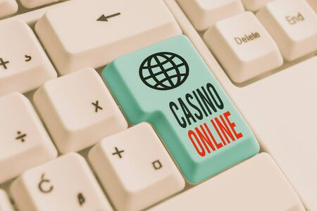 Word writing text Casino Online. Business photo showcasing Computer Poker Game Gamble Royal Bet Lotto High Stakes White pc keyboard with empty note paper above white background key copy space