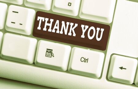 Word writing text Thank You. Business photo showcasing a polite expression used when acknowledging a gift or service White pc keyboard with empty note paper above white background key copy space Stok Fotoğraf