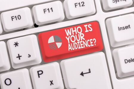 Conceptual hand writing showing Who Is Your Audience Question. Concept meaning who is watching or listening to it White pc keyboard with note paper above the white background