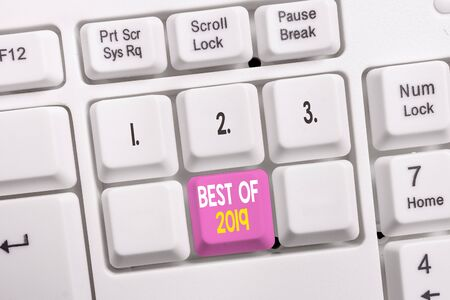 Conceptual hand writing showing Best Of 2019. Concept meaning great and marvelous things and events happened on 2019 White pc keyboard with note paper above the white background Stock Photo