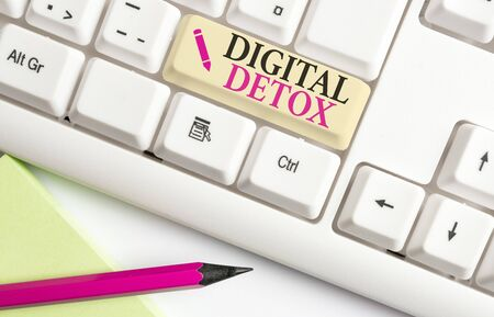 Handwriting text writing Digital Detox. Conceptual photo Free of Electronic Devices Disconnect to Reconnect Unplugged White pc keyboard with empty note paper above white background key copy space Stock Photo