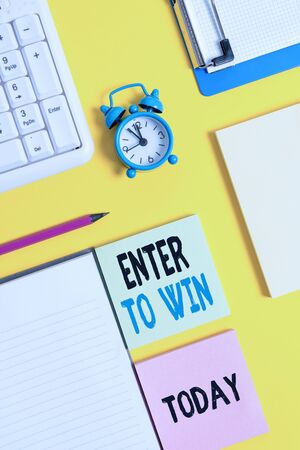 Conceptual hand writing showing Enter To Win. Concept meaning exchanging something value for prize or chance of winning Crumpled white paper on table clock mobile and pc keyboard Фото со стока