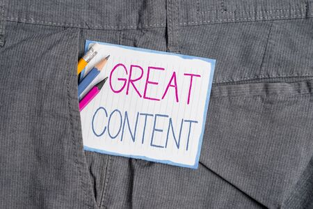 Handwriting text Great Content. Conceptual photo Satisfaction Motivational Readable Applicable Originality Writing equipment and white note paper inside pocket of man work trousers Stock Photo
