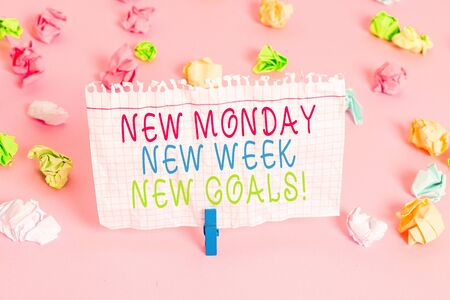 Conceptual hand writing showing New Monday New Week New Goals. Concept meaning goodbye weekend starting fresh goals targets Colored crumpled papers empty reminder pink floor clothespin