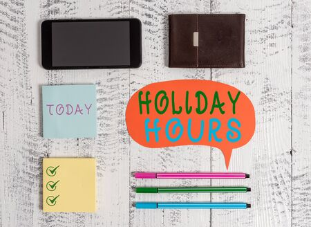 Word writing text Holiday Hours. Business photo showcasing Schedule 24 or7 Half Day Today Last Minute Late Closing Smartphone pens blank speech bubble sticky notes wallet wooden background Imagens