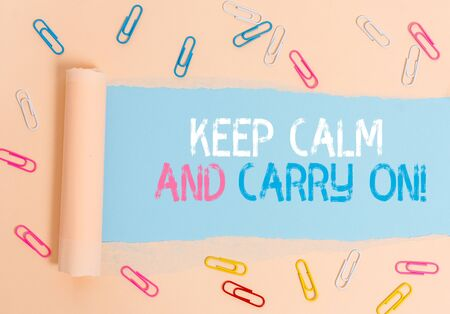 Conceptual hand writing showing Keep Calm And Carry On. Concept meaning slogan calling for persistence face of challenge 写真素材