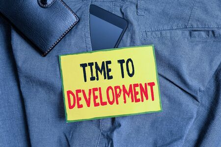 Conceptual hand writing showing Time To Development. Concept meaning a length of time during which a company grows or develop Smartphone device inside trousers front pocket with wallet