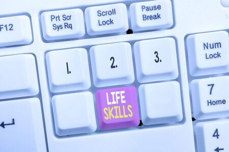 Conceptual hand writing showing Life Skills. Concept meaning skill that is necessary for full participation in everyday life White pc keyboard with note paper above the white background