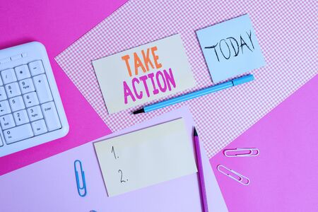 Handwriting text Take Action. Conceptual photo to do somethingoract in order to get a particular result Writing equipments and computer stuffs placed above colored plain table Stock fotó