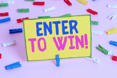 Word writing text Enter To Win. Business photo showcasing exchanging something value for prize chance winning prize Colored clothespin papers empty reminder pink floor background office pin