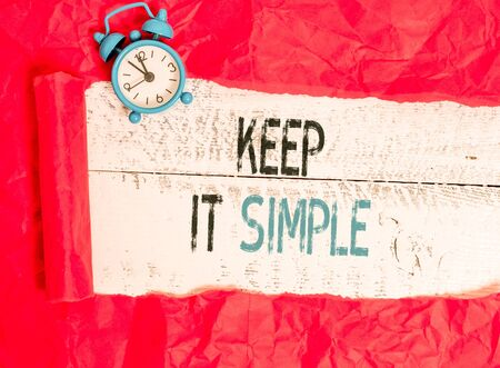 Writing note showing Keep It Simple. Business concept for to make something easy to understand and not in fancy way Stock Photo - 129853722