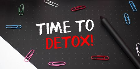Writing note showing Time To Detox. Business concept for when you purify your body of toxins or stop consuming drug Scissors and writing equipments plus math book above textured backdrop