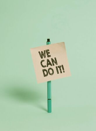 Handwriting text We Can Do It. Conceptual photo see yourself as powerful capable demonstrating Ballpoint blank colored sticky note peaceful cool pastel fashion background