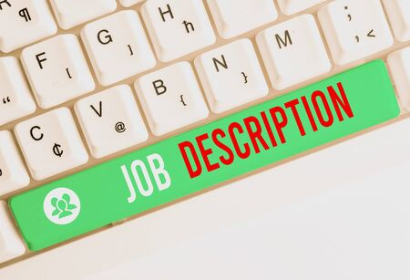 Writing note showing Job Description. Business concept for a formal account of an employee s is responsibilities White pc keyboard with note paper above the white background