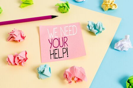 Writing note showing We Need Your Help. Business concept for asking someone to stand with you against difficulty Colored crumpled papers empty reminder blue yellow clothespin Stockfoto