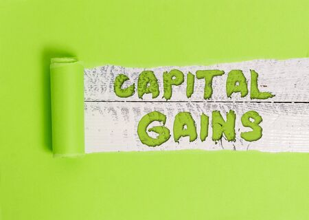 Word writing text Capital Gains. Business photo showcasing Bonds Shares Stocks Profit Income Tax Investment Funds