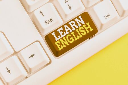 Word writing text Learn English. Business photo showcasing Universal Language Easy Communication and Understand White pc keyboard with empty note paper above white background key copy space