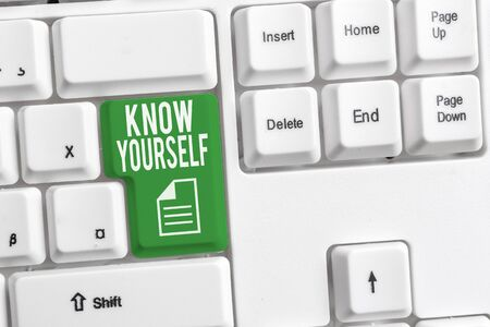 Conceptual hand writing showing Know Yourself. Concept meaning Find You Understanding Strength and Weaknesses Identity White pc keyboard with note paper above the white background Stock Photo - 129853660