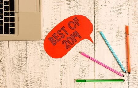 Handwriting text writing Best Of 2019. Conceptual photo great and marvelous things and events happened on 2019 Open laptop blank speech bubble pens ballpoints lying vintage wooden table Stock Photo