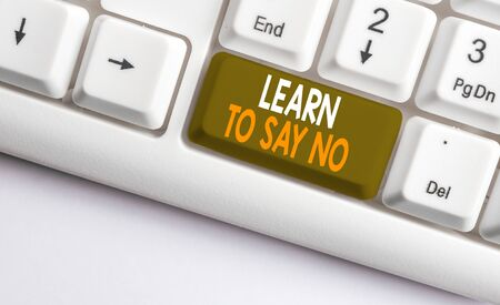 Text sign showing Learn To Say No. Business photo showcasing decline or refuse few things before you destroy yourself White pc keyboard with empty note paper above white background key copy space