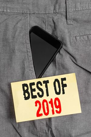 Word writing text Best Of 2019. Business photo showcasing great and marvelous things and events happened on 2019 Smartphone device inside formal work trousers front pocket near note paper Stock Photo