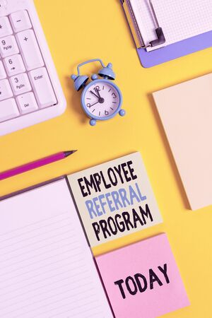 Conceptual hand writing showing Employee Referral Program. Concept meaning employees are rewarded for introducing recruits Crumpled white paper on table clock mobile and pc keyboard