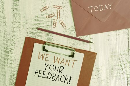 Conceptual hand writing showing We Want Your Feedback. Concept meaning criticism given someone say can be done for improvement Colored clipboard paper sheet pencil clips wooden background