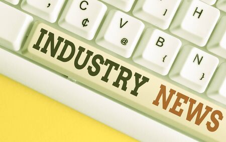 Text sign showing Industry News. Business photo text Technical Market Report Manufacturing Trade Builder White pc keyboard with empty note paper above white background key copy space