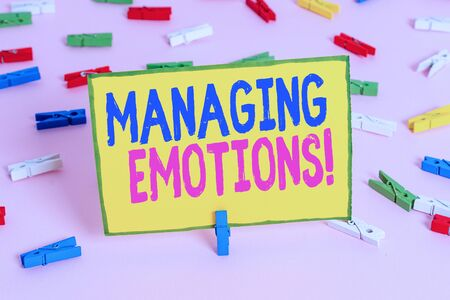 Word writing text Managing Emotions. Business photo showcasing ability be open to feelings and modulate them in oneself Colored clothespin papers empty reminder pink floor background office pin Stock fotó