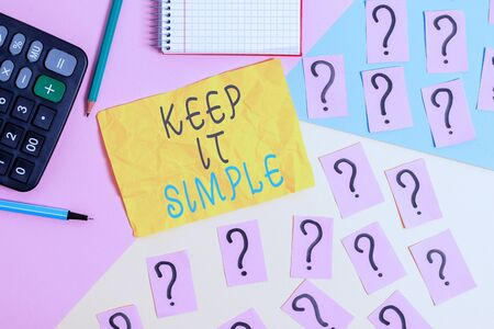 Writing note showing Keep It Simple. Business concept for to make something easy to understand and not in fancy way Mathematics stuff and writing equipment above pastel colours background Stock Photo - 129853589