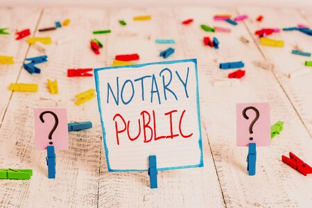 Conceptual hand writing showing Notary Public. Concept meaning Legality Documentation Authorization Certification Contract Crumbling sheet with paper clips placed on the wooden table