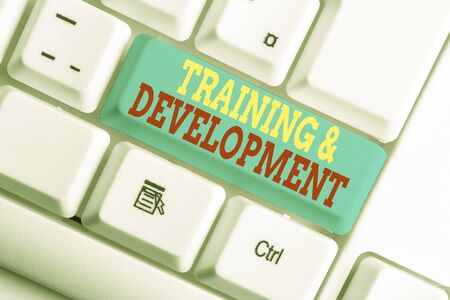 Text sign showing Training And Development. Business photo showcasing learn specific knowledge to improve perforanalysisce White pc keyboard with empty note paper above white background key copy space Stock fotó