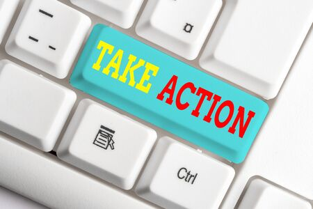 Text sign showing Take Action. Business photo showcasing to do somethingoract in order to get a particular result White pc keyboard with empty note paper above white background key copy space Stock fotó