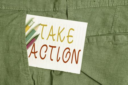 Word writing text Take Action. Business photo showcasing to do somethingoract in order to get a particular result Writing equipment and white note paper inside pocket of man work trousers
