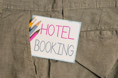 Handwriting text Hotel Booking. Conceptual photo Online Reservations Presidential Suite De Luxe Hospitality Writing equipment and white note paper inside pocket of man work trousers